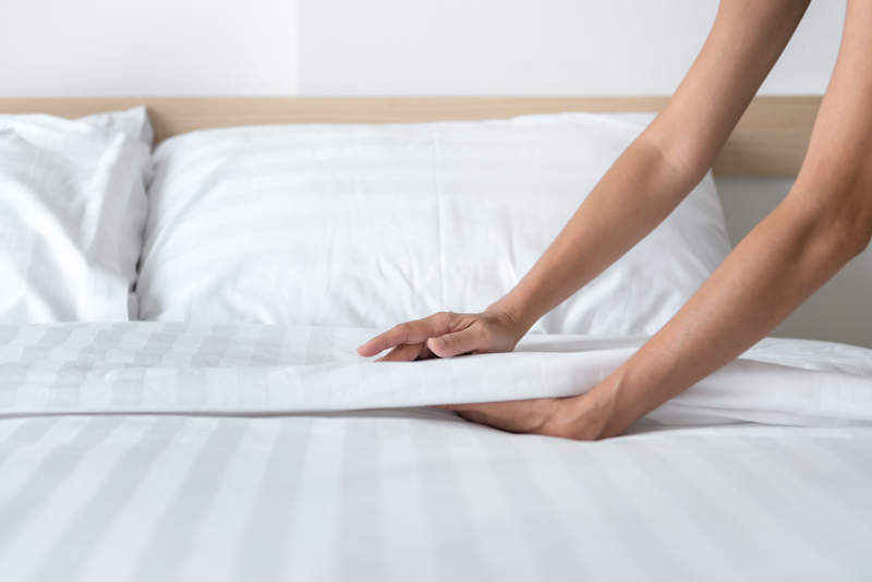 Fresh sheets and bedding for a clean mattress