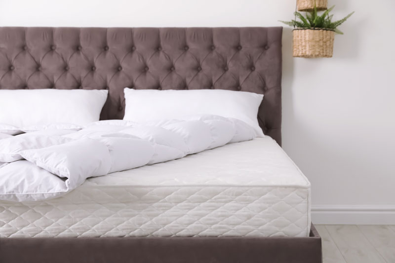 Removing Bedding to Clean a Mattress